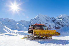 Snowplow in the mountains prepairing piste Royalty Free Stock Photo