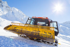 Snowplow in the mountains prepairing piste Royalty Free Stock Images