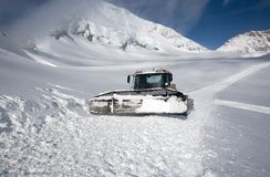 Snowplow on mountainside Royalty Free Stock Photos