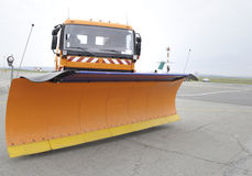 Snowplow in parking. Snowplow - snow removal vehicle used during blizzards parked. Useful file for your brochure about road security or airport security during Stock Photography