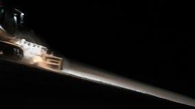 Snowplow preparing a ski slope stock video footage