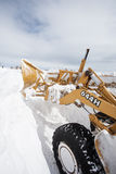 Snowplow Pushes Snow Royalty Free Stock Photography