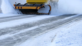 Snowplow Removes Snow Off Road Stock Photography