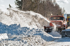 Snowplow removes snow Royalty Free Stock Photos