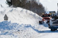 Snowplow removing snow. From intercity road from snow blizzard Royalty Free Stock Photo