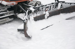 Snowplow. Removing snow from city road Stock Image