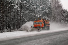 Snowplow removing snow from intercity road Stock Photography