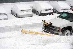 Snowplow removing snow on the street Royalty Free Stock Photography