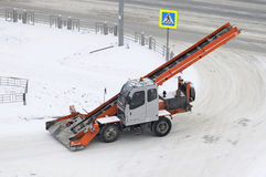 The snowplow on the road. Stock Photography