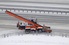 The snowplow on the road. Royalty Free Stock Photography
