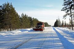 Snowplow on Rural Road. A snowplow clears a rural road in Wisconsin Royalty Free Stock Photo