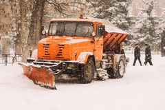 The snowplow stands on the street during the day Stock Photography