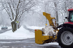Snowplow on the street. At winter royalty free stock photography