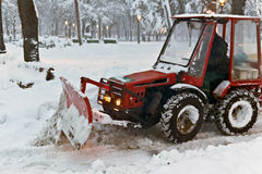 Snowplow Tractor cleaning snow Stock Image