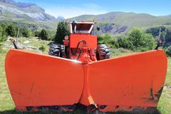 Snowplow tractor in mountain outdoor. In spring season Stock Photo