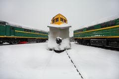 Free Snowplow Train Or Snow Removal Train With Railroad Snow Removal Equipment For Cleaning Tracks Ans Rails From Snow Stays Stock Photography - 131186012