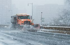 Snowplow Truck Cleans The Highways And Interstate During Blizzard Conditions During Nor`Easter In New England USA Royalty Free Stock Photos