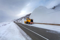 Snowplow truck Snow removal truck is removing the snow from the highway during a cold snowstorm winter day. Snowplow truck Snow removal truck is removing the Royalty Free Stock Image