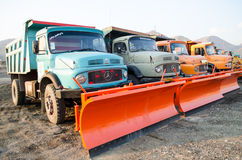 Snowplow Trucks. Colorful snowplow scrapers trucks parked Stock Images