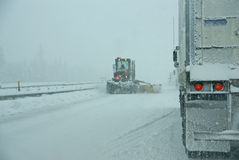 Snowplow and trucks during snowstorm Stock Photos