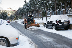 Snowplow Vehicle and Workers Royalty Free Stock Photography