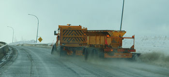 Snowplow Winter Driving Conditions Stock Photo
