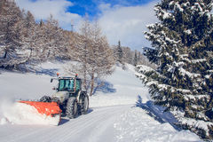 Snowplow. Winter landscape with snowplow, mountains and trees Royalty Free Stock Photos