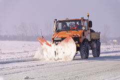 Snowplow winter road Royalty Free Stock Photography