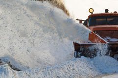 Snowplow at work. Snowplow removing snow from intercity road from snow blizzard Stock Image