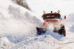 Snowplow at work. Snowplow removing snow from intercity road from snow blizzard Royalty Free Stock Photos