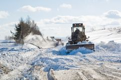 Snowplow at work. Snowplow removing snow from intercity road from snow blizzard Stock Photography