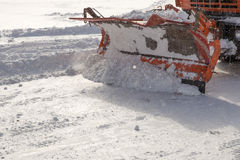 Snowplow at work. Snowplow removing snow from city road Royalty Free Stock Photography