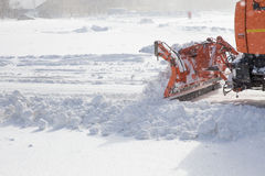 Snowplow at work. Snowplow removing snow from city road Royalty Free Stock Photos