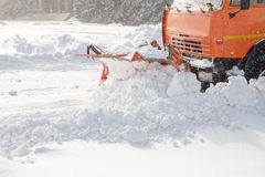 Snowplow at work. Snowplow removing snow from city road Stock Photography