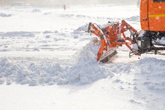 Snowplow at work. Snowplow removing snow from city road Stock Image