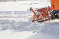 Snowplow at work. Snowplow removing snow from city road Stock Photo