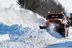 Snowplow at work. Sim, Russia - February 25, 2008: Snowplow removing snow from intercity road from snow blizzard Royalty Free Stock Images