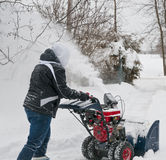Snowplowing The Driveway Stock Photo