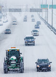 Snowplows and Cars on the Highway Royalty Free Stock Image