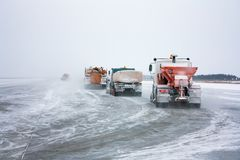 Snowplows cleans the runway. Snowplows cleans the winter runway Royalty Free Stock Images