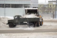 Snowplows on the streets Royalty Free Stock Image