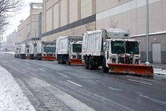 Snowplows waiting for blizzard