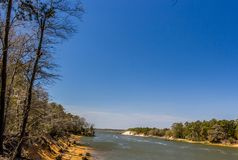 Snows Cut in North Carolina connects the Cape Fear River with the North Bound Inter Coastal Waterway. Strong current. Blue sky. trees Royalty Free Stock Photos