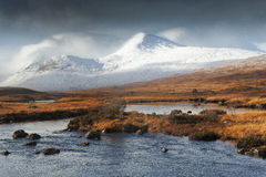 Snows on Rannoch Moor Hills. Clach Leathad hidden in cloud with the summit of Meall a Bhuiridh just clear of clouds for a few minutes on a winter day. Viewed royalty free stock photo
