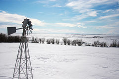 Snowscape. Big Sky Snowscape with Windmill in the foreground Royalty Free Stock Photo