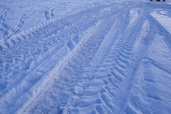 Snowscape with skid marks into the snow Royalty Free Stock Photo