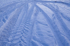 Snowscape with skid marks into the snow Royalty Free Stock Image