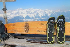 Snowshoe on bench. With Alps Stock Photo