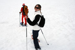 Snowshoe fun. Teenage girl enjoys snowshoeing in French alps Stock Photography