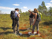 Snowshoe hike. Group of young people exploring nature on a snowshoe hike in Store Mosse Nationalpark, Sweden Stock Photo